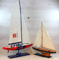 Two scale models of sailing boats