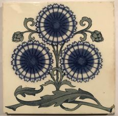 Art Nouveau tile with stylized flowers