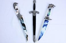 Three daggers, including two with images