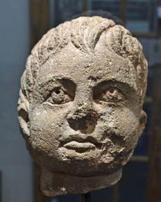 An Ertruscan volcanic tuff stone head of a boy - 15cm