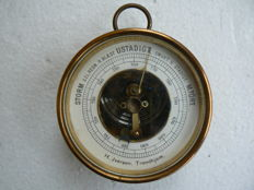 H. Iversen desk barometer ca. 1900 and a large field compass in a leather case