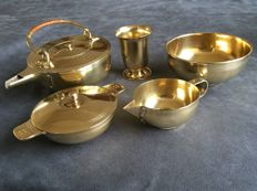 Jan Eisenloeffel, five-piece brass tea set, unmarked, teapot, sugar bowl, creamer, spoon cup and serving dish, Art Deco