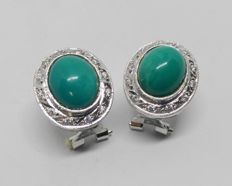 earrings in 18 kt white gold with green-blue stones and zirconias
