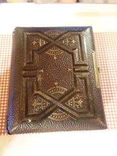 An embossed leather album with 30 old chromo Liebig cards