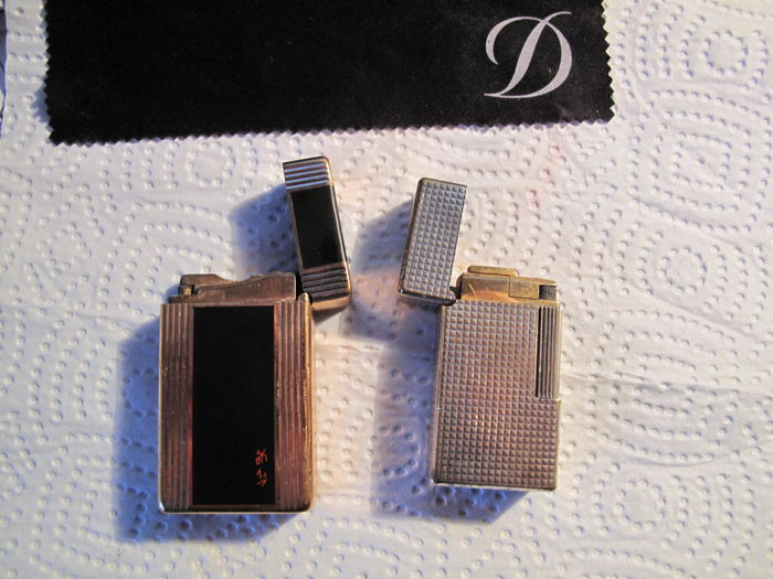 2 Dupont lighters in black Chinese lacquer, hallmark, France and 1 silver, Vinci