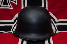 WWII German steel helmet with inlay and uniform leather belt