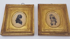 A framed silhouette of a gentleman and a lady - English - early 19th century