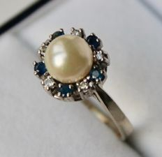 White gold ring with a perfect sea/salty Akoya pearl from the Japanese sea and natural small Sapphires and diamonds.