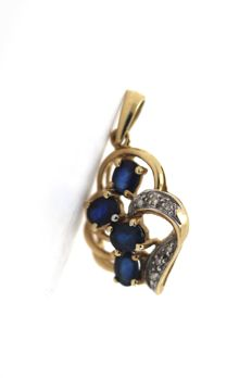 Pendant in 14 kt/585 yellow gold with diamonds 0.06 ct SI W and 4 sapphires totalling 0.80 ct