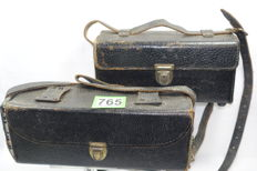 Two vintage battery packs in leather bags