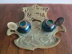 Art Nouveau brass inkstand with whip motives