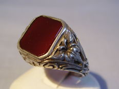 Antique men's ring with octagonal carnelian disc weighing 5 ct, surrounded by fine ornamentation, made circa 1900