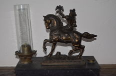 Old oil lamp with falconry scene