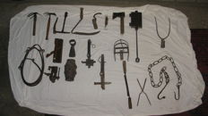 Collection of antique farm tools from a collector