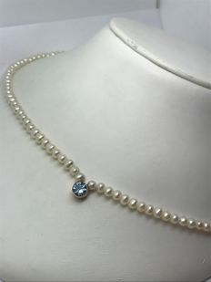 Pearl necklace with small pearls and aquamarine pendant approx. 0.5 ct in brilliant cut