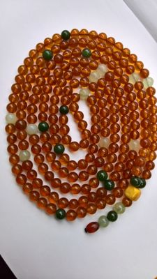 Baltic Amber necklace honey colour with Nephrite- Jade, manufactured in Kaliningrad Amber plant.