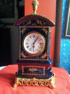 "Blue porcelain clock with gold finish, decorator ""Mignon"""