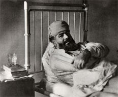 Robert Capa (1913-1954) - Ernest Hemingway in hospital, London, 1944