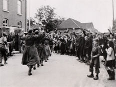 Unknown/US Signal Corps/ACME - German Prisoners being escorted, Limbricht, Holland, 1944