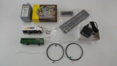"Faller H0 - Car System Starter set: Mercedes-Benz lorry ""GLS"", running wiring 2 x 10m, battery charger, bus-stop, street surfacing, road markings, and an extra school bus"