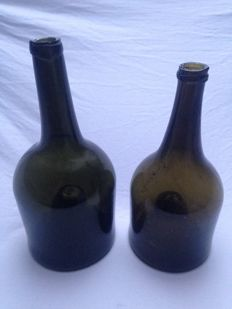 Two dark green glass wine bottles, with high kick, Southern Netherlands, late 18th century