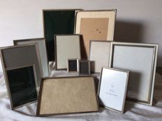Collection of 12 silver-plated photo frames, three of which with convex glass