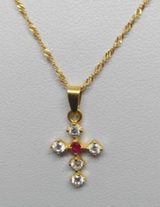 Chain and pendant in 18 kt yellow gold - Zirconias