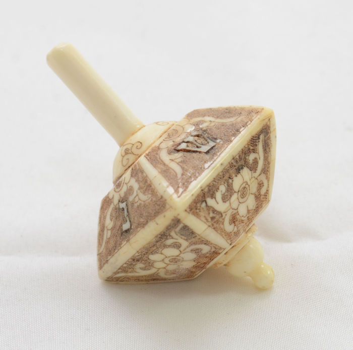 Judaica - dreidel - spinning top for Hannukah - bone - trapezoid -  hebrew - Austria - ca. 1920's