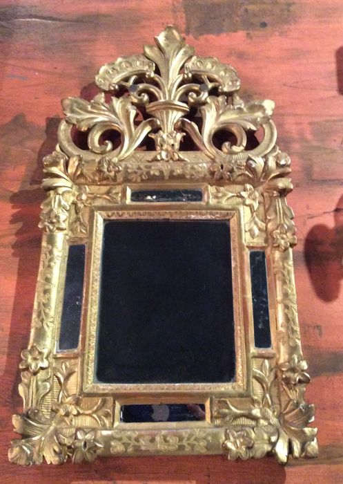 Provincial mirror Louis XIV in stucco and gilt wood - France - circa 1710