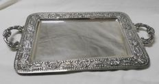 Tray in marked silver - silversmith J. Roca - with plain decoration in the centre and embossed edges and handles - Spain - 20th century