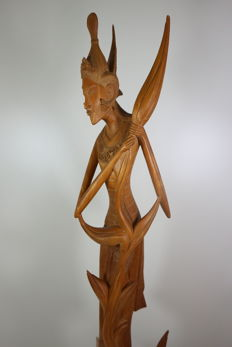 Wood carving of the rice goddess Dewi Sri - Bali - Indonesia - c. 1960