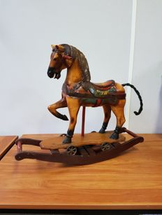 Painted wooden rocking horse with braided tail of real horsehair - two piece with iron wheels