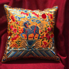 A pillowcase with many colors and embroidery patterns.