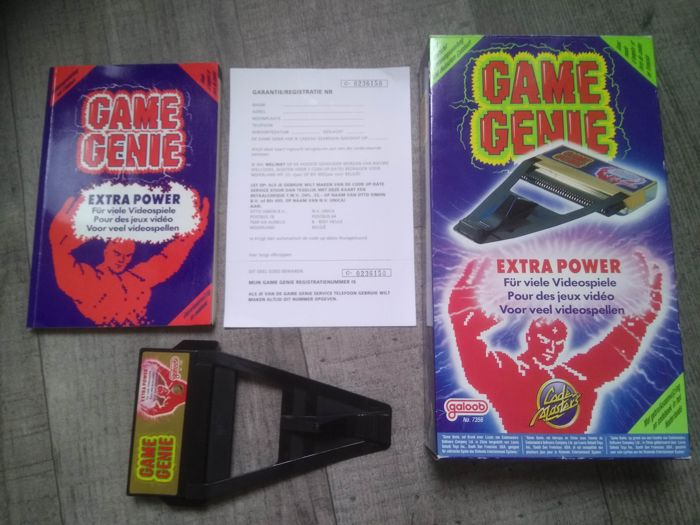 Nintendo NES - Game Genie - Complete in original box, with code book & registration card