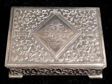 An , amazing , vintage , silver plated bronze , table CIGARETTE BOX , with coat of arms in the cover , and surface engraved with garlands