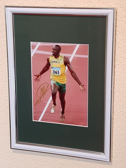 Usain Bolt - Olympic Legend 100 en 200 m - fantastic hand signed photo + COA.