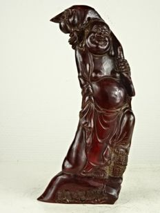 Buffalo horn sculpture of a Budai - China - second half of the 20th century
