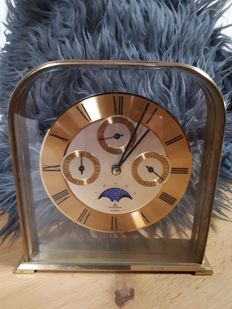 Dugena quartz clock with moon phases, date, months, days, hours and minutes - 2nd half 20th century