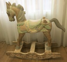 Almost a meter tall, solid hand-carved rocking horse in pastel colours