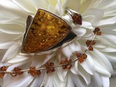Vintage silver set: bracelet, ring and a pendant with amber, 34 grams in total