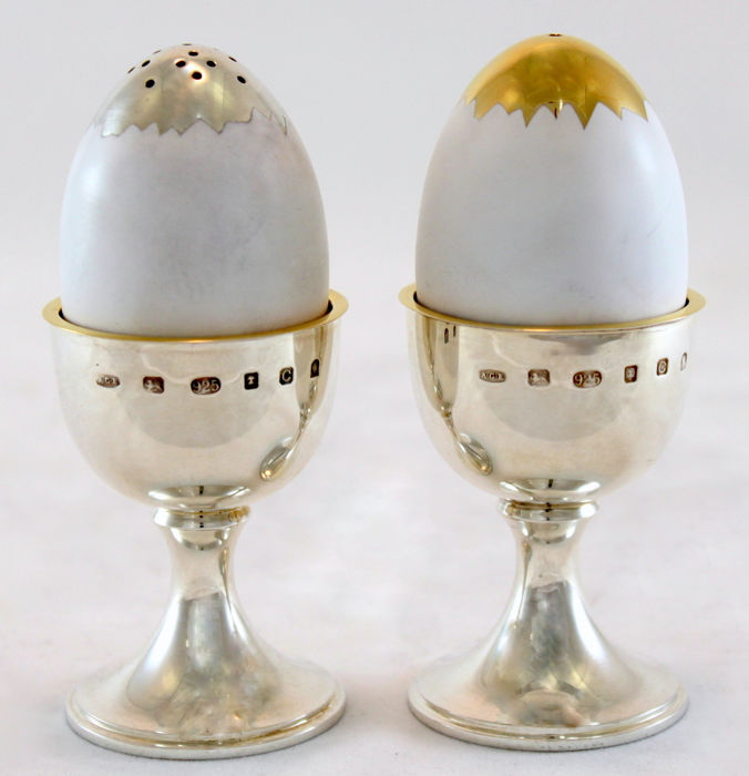 A pair of silver and enamel egg form condiments - Anthony Elson - London - 2002