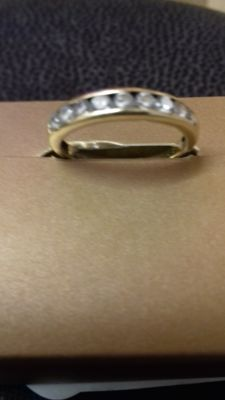 ladies 9crt yellow gold,, eternity ring, with 9 small diamonds