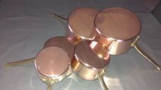 Set of five French made copper pans in good condition