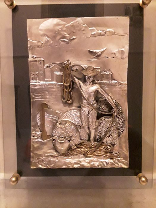 Painting of fisherman pulling back fishing nets - on silver foil - framed in mahogany