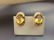 Earrings in 18 kt gold with topaz, 14 ct, and diamonds