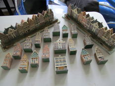 Large collection of Amsterdam canal houses miniatures, 35 items
