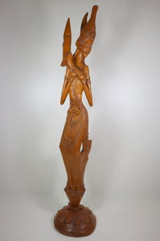 Wood carving of the rice goddess Dewi Sri - Bali, Indonesia - around 1950
