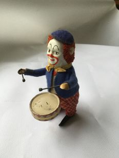 Schuco, Germany - height 11 cm - wind-up clown with drum