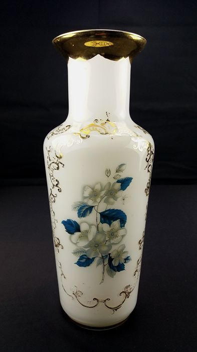 Antique opaline glass vase with painted floral patterns on a white background