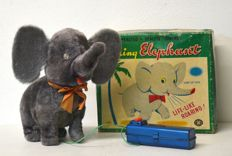 Modern Toys, Japan - height cm 23 - Walking elephant - wire-controlled tin toy - automaton - 1950s